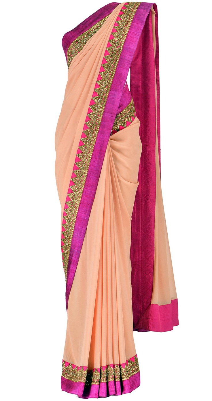 #Sabyasachi sari. The first salmon pink sari I've liked, ever! Salmon pink georgette saree with fuschia silk border embellished with gold embroidery.