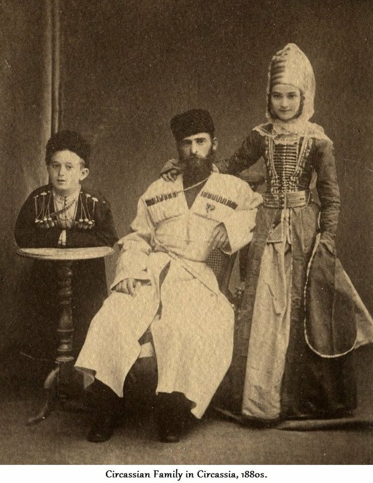 a tradtional Circasiian family in traditional dress...they would certainly had to at least landed gentry or upper middle class judging by their outfits.