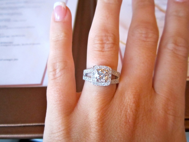 My e ring Round diamond with a square halo around it Split shank band Need