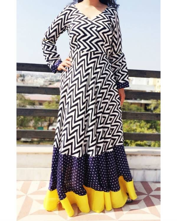 Retro maxi dress    Floor length black and white zig zag maxi dress. The dress has a double graded border. It is perfect to rock the retro look for a party. Team it with chunky earrings to complete that 60s look.