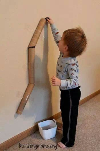 "Fun activity: Use painters tape and attach paper towel rolls to the wall. Let toddler drop balls down the ""chute"""
