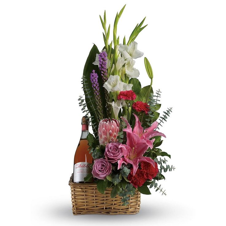 Go all out for your special someone - Stimulating #basket with assorted mixed #flowers and a bottle of #wine.