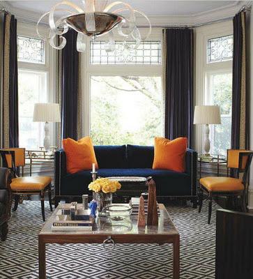 navy sofa w/orange accents.