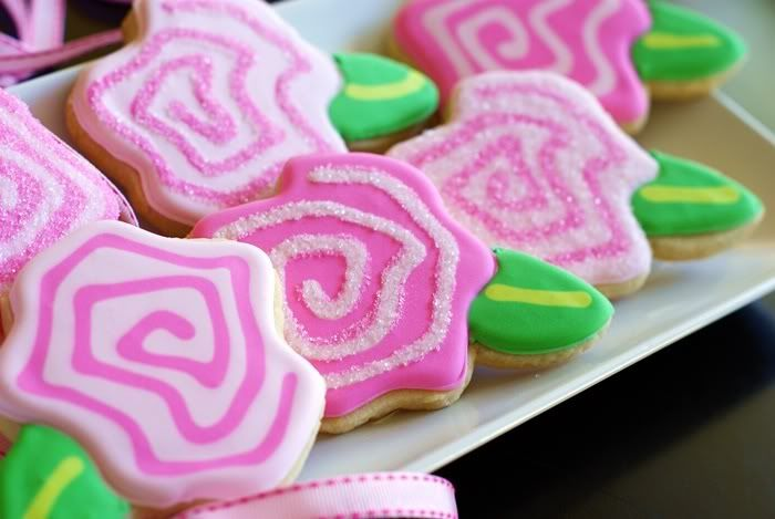 Frosted Swirly Pink Rose decorated cookies, made from a template