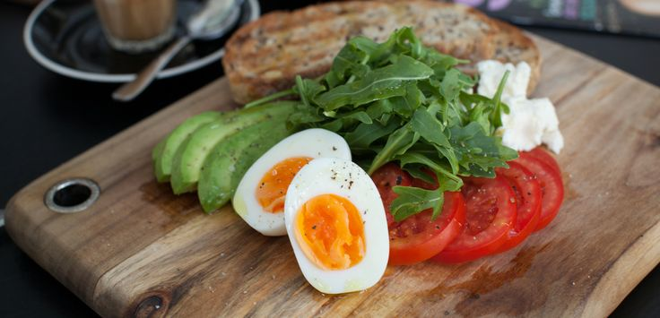 The Healthy Breakfast, Soft boiled egg, fluffy ricotta, roma tomato, avocado, rocket and soy quinoa toast Photography by Bridget O'Brien