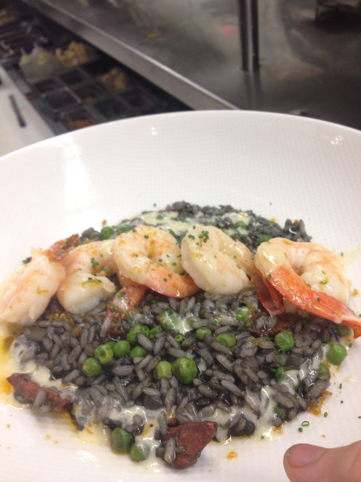 Squid ink risotto, butter poached prawns, lemon buerre blanc