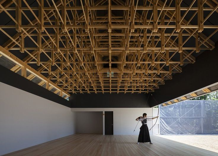 Archery hall and boxing club at Kogakuin University in Tokyo, Japan, by FT Architects built from complex wooden lattices.