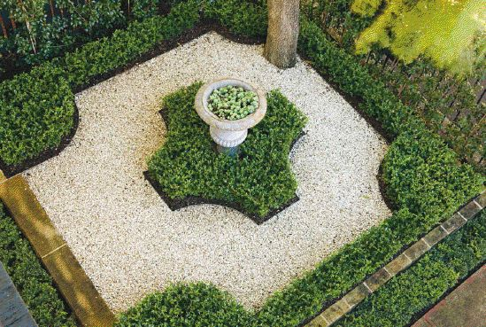 Small formal, low maintenance front garden (Peter Fudge design).