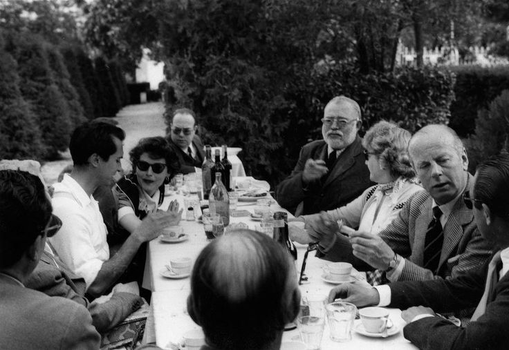 One fabulous table- Ava lunching with the Hemingways and her then love interest, legendary matador Luis Miguel Dominguin. Spain, 1954