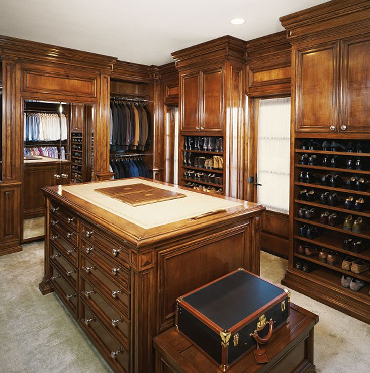 Beautiful hardwood walk-in closet with island and ample shoe storage