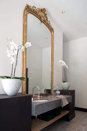 Such a powerful and trully feminine ambience for a woman. The giant golden mirror is the master piece