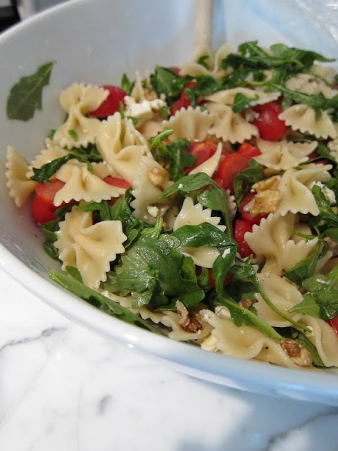 Quick pasta salad:  This is a bright, colorful side dish that's both tasty and easy!   1 Lb. bow-tie pasta; 4 Cups Baby Arugula; 2 Cups Grape Tomatoes, halved; 1/2 Cup Toasted Walnuts; 1/2 Crumbled Blue Cheese; 3 Tbsp. EVOO; 3 Tbsp. White Wine Vinegar: 1/2 tsp. Salt; 1/2 tsp. Pepper