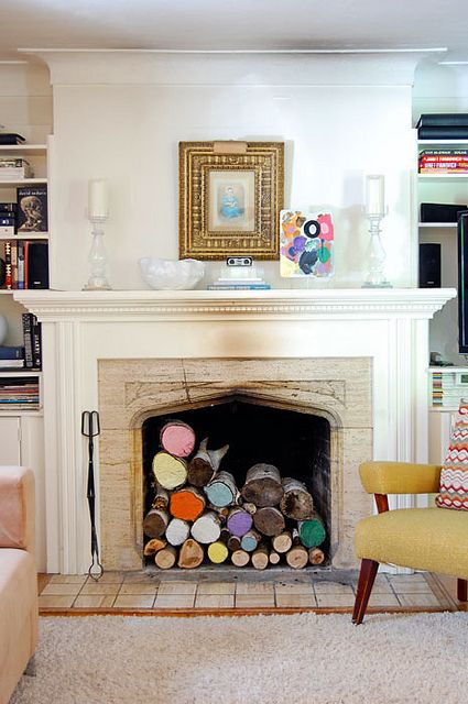 painted-logs-in-fireplace by The Art of Doing Stuff  What to do with your fireplace in the summer!