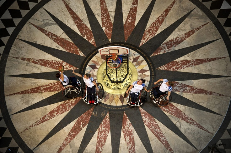Britain's wheelchair basketball players, Sarah Grady, Judith Hamer, Helen Turner and Louise Sugden practice shooting baskets under the dome in St Paul's Cathedral in London, on August 24, 2012 ahead of the start of the London 2012 Paralympic Games (Adrian Dennis/AFP/Getty Images) #