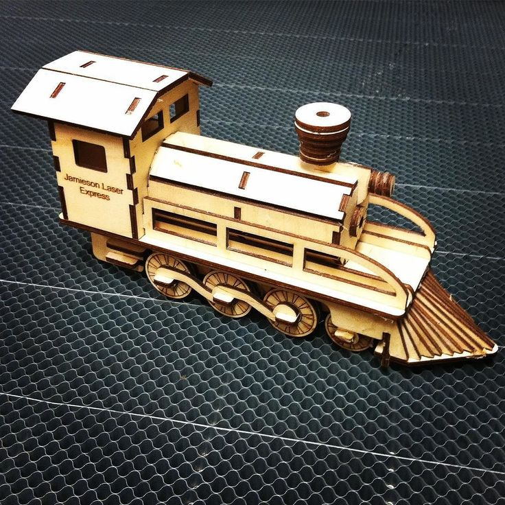 A wooden model train cut out with Jamieson Laser machine and assembled. #laser #lasercut #trains #modelmaking by jamiesonlaser