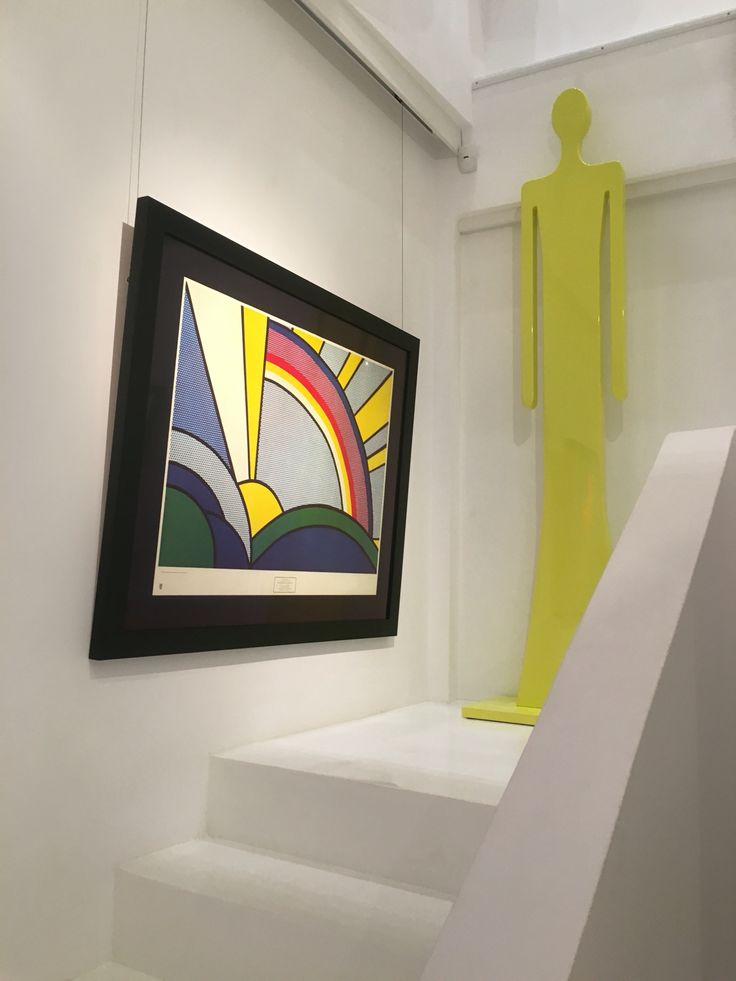 """Vassiliki's sculpture artwork """" Guard"""" on exhibition next to one of her favourite painting """" Sun rays"""" by Roy Lichtenstein."""