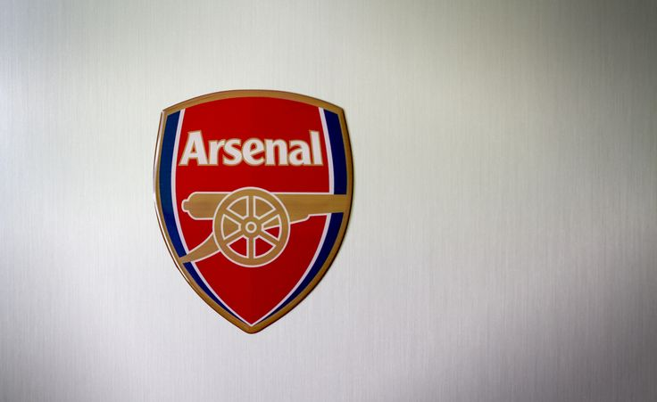 Domed resin strong magnet on the fridge door. Arsenal!