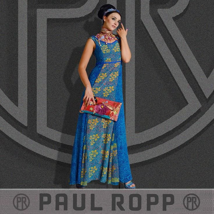 The Nora Dresses are printed on silk, are hand woven and hand braided. These Dresses are available in 4 color themes.