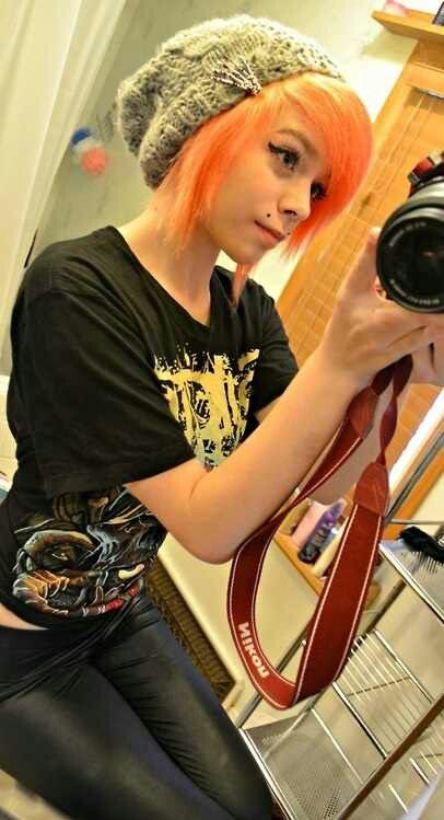 i think I might do something like this with my hair, but darker brighter orange, though I'm not really sure yet on the cut.