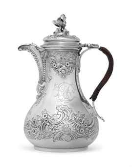 A GEORGE II SILVER COFFEE JUG MARK OF PAUL DE LAMERIE, LONDON, 1744 Baluster form on circular foot, the body chased with rocaille, scrolling shells and foliage, the spout with scales and shell ornament, the domed and hinged cover with coffee plant and bean finial, with a leather-covered scroll handle, the body engraved with a later 18th-century script monogram,