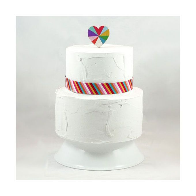 Brides.com: . Crown your confection with this sweet wooden topper handpainted in rainbow hues. Love is Beautiful cake topper, $40, The Small Object