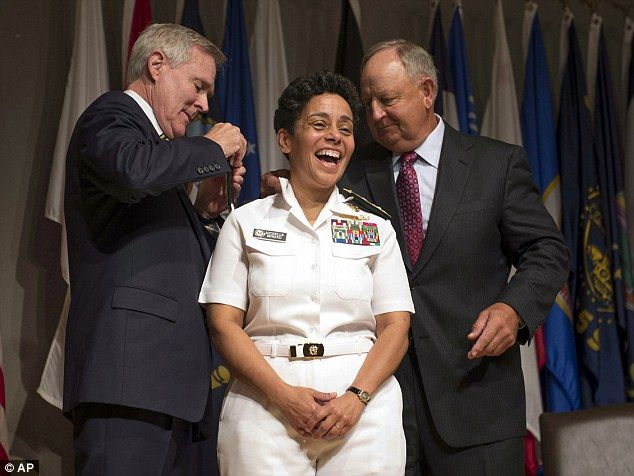 Historical: U.S. Navy, Adm. Michelle Howard, center, smiles as Secretary of the Navy Ray Mabus, left, and Wayne Cowles, Howard's husband, put four-star shoulder boards on Howard's service white uniform during her promotion ceremony at the Women in Military Service for America Memorial in Washington