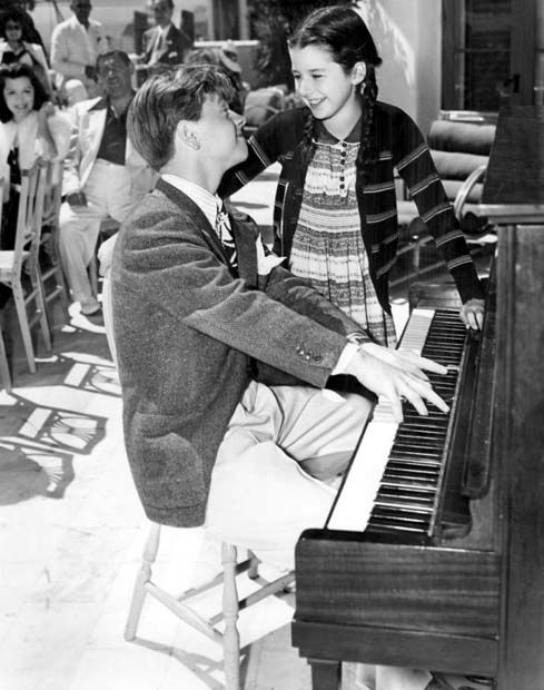 Mickey Rooney and Virginia Weidler entertain guests at Louis B. Mayer's birthday party for Judy Garland