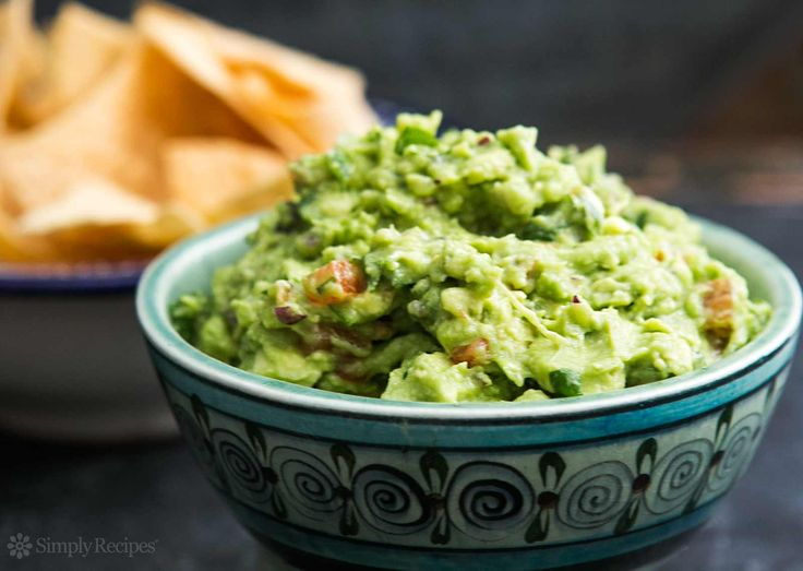 BEST guacamole ever! So EASY to make with ripe avocados, salt, serrano chiles, cilantro and lime. On SimplyRecipes.com
