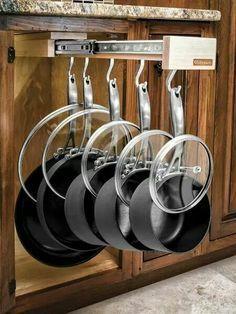 Pots, pans, lids organized in hanging sliding drawer - kitchen organization ideas