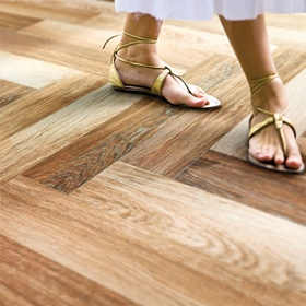 Tile that looks like wood!!! Totally would do this in my house because of the dogs nails!! Won't get scratched!