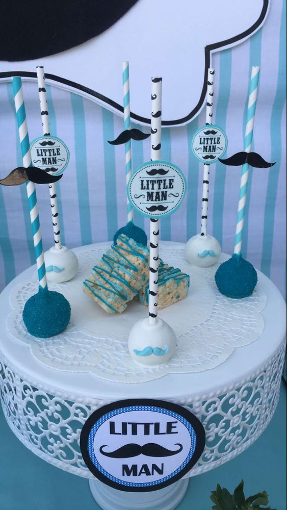 Fun cake pops at a mustache baby shower party! See more party planning ideas at CatchMyParty.com!
