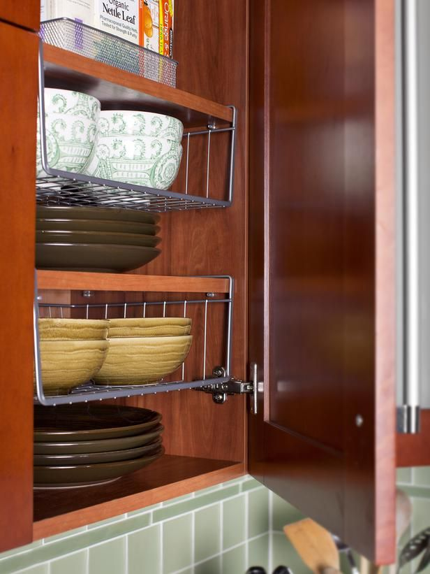 Shelving space inside wall-mounted cabinets is maximized with stackable wire racks. The racks come in different heights and widths and allow various sizes of plates to stack neatly within the same cabinet.