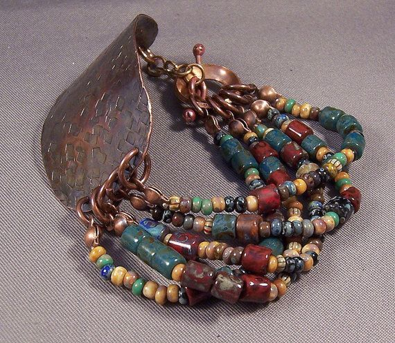 Inspiration ... cute idea. Thick leather could be used instead of the copper band. Handmade Forged Metal and Bead Bracelet by Mona - Tribal - Deep Rich Colors Czech Mixed Beads Copper Boho 2013