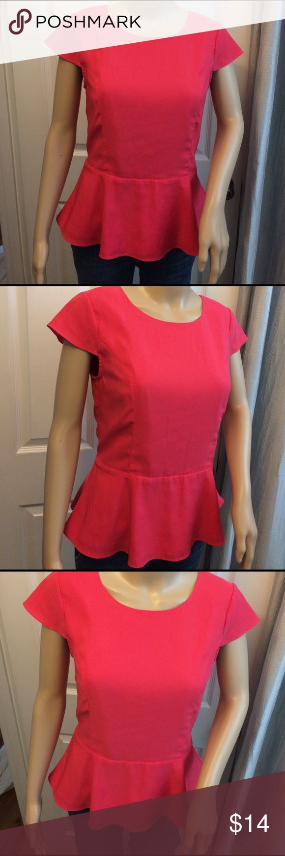 Express Peplum Top Express brand coral pink color peplum top. Gold zipper backing that unzips all the way. Very pretty top lined with silky polyester. No stains or holes. Cap sleeves. Express Tops Blouses