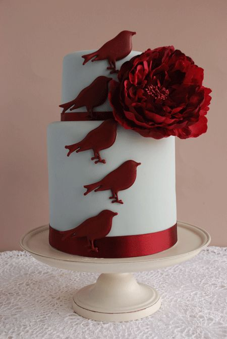 two tier white fondant cake with red gum paste birds and flower
