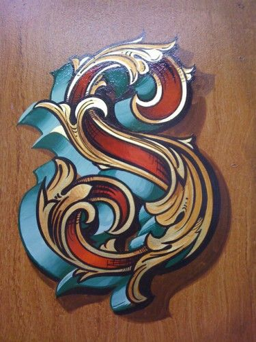 Fancy letter S in Gold leaf and painted decoration