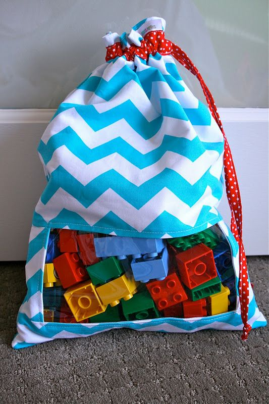 """""""Peek-A-Boo"""" Toy Sacks Tutorial!!! I LOVE this idea! Would look so cute all hanging in a row, and might make it more interesting for the kids to clean up... Just hand them a bag and tell them to fill it up! (like the car bag they should fill up with cars). Make a fun game out of it! :)"""