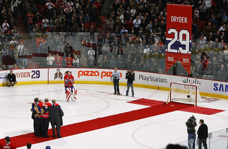 Ken Dryden, former goaltender of the Montreal Canadiens, and his family watch as his jersey #29 is retired by the Montreal Canadiens during a ceremony before a game between the Ottawa Senators and the Canadiens. (Getty Images)