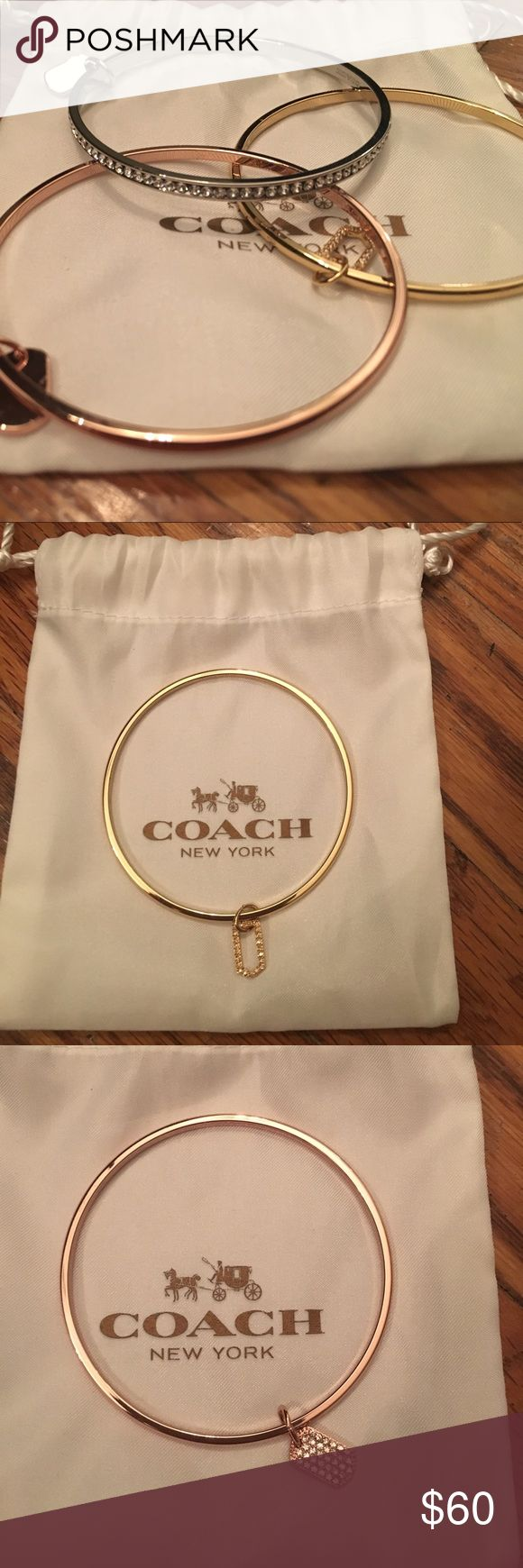 NWOT 3 Coach Bracelets NWOT 3 Coach Bracelets in silver, gold and rose gold. The silver bracelet has fake diamonds around the side. These Bracelets are a stand out piece and can help dress up or down an outfit! Comes with white coach duster Coach Jewelry Bracelets