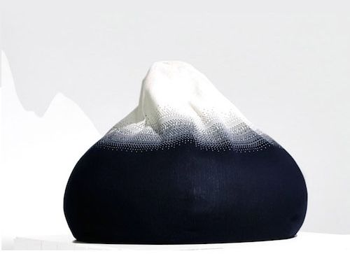 knitted mountain poof. The fact that it's knitted is against it, not easy to clean of pet hair, but the simple color concept! A mountain, get it? Brilliant! #seating