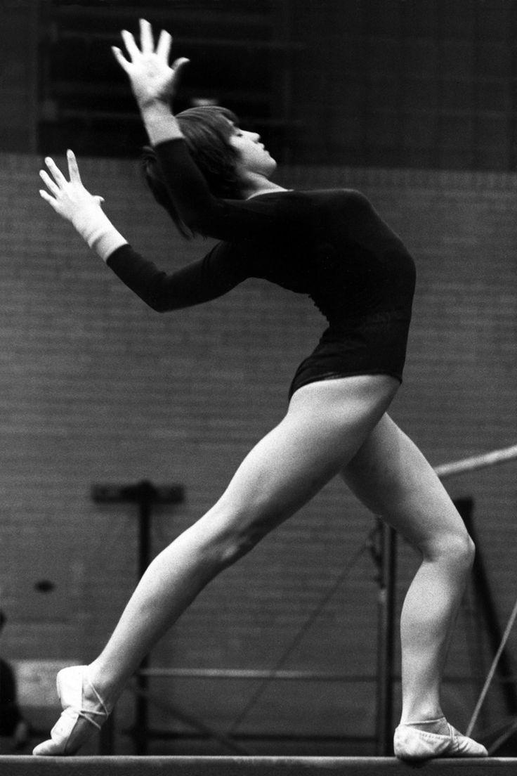Gymnast Nadia Comaneci performing on balance beam (1977).