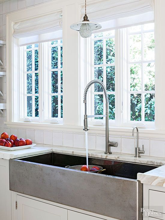 Apron-front sinks, such as this modern stainless-steel model, let you pile in the dirty dishes to soak while you continue socializing. Try a double-basin sink to separate pots and pans from fine glassware.