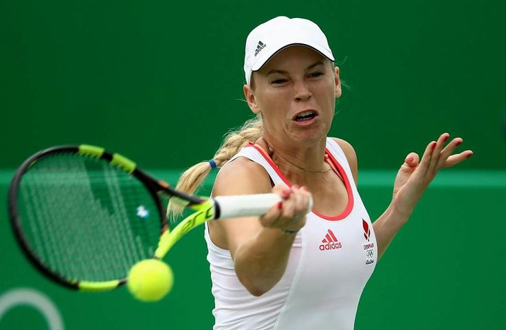 RIO DE JANEIRO, BRAZIL - AUGUST 07: Caroline Wozniacki of Denmark plays a forehand against Lucie Hradecka of Czech Republic in their first round match on Day 2 of the Rio 2016 Olympic Games at the Olympic Tennis Centre on August 7, 2016 in Rio de Janeiro, Brazil. (Photo by Cameron Spencer/Getty Images)