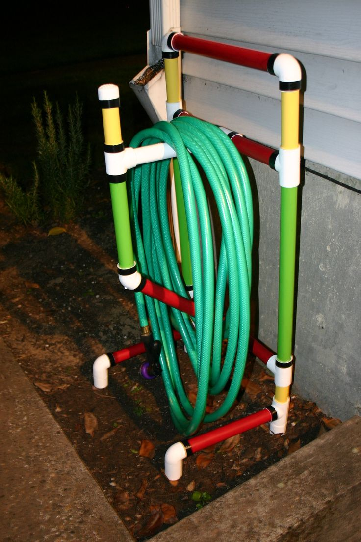 A garden hose cart made from 1 inch PVC pipe. Painted with outdoor acrylics and electrical tape for black trim. Instructions here: http://www.pvcworkshop.com/freePVCplans3.htm