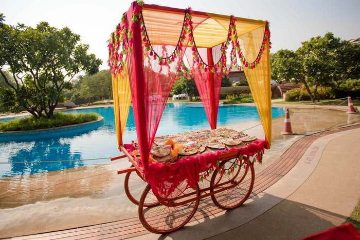 Mehendi decor, food tents for an Indian wedding event