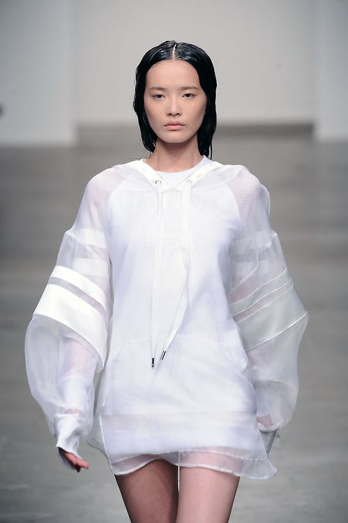 A brilliant execution of the minimalist sport trend at skingraft yesterday. We're loving the voluminous sheer sleeves with luxe stripe...