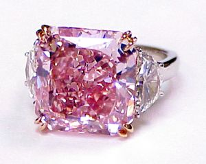 Large Pink Diamond Engagement Ring.  Find out more about our engagement rings at http://diamondexchangedallas.com/engagement-rings-dallas