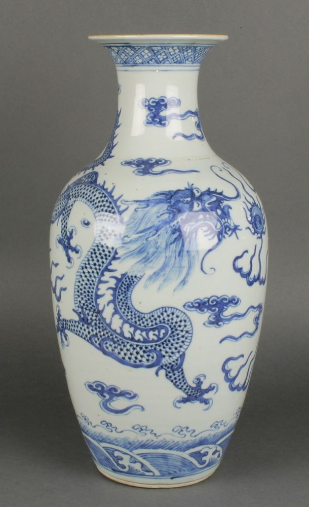 """Lot 121, A late 19th Century Chinese oviform vase with waisted neck, the blue and white decoration with dragons chasing the flaming pearl 17"""", sold for £680"""