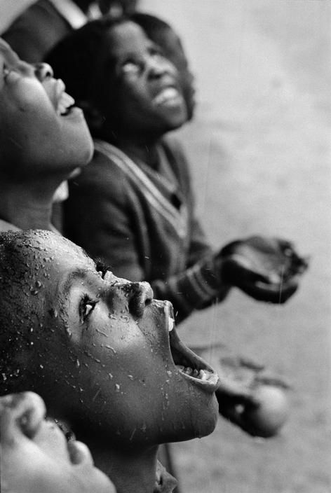 Chris Steele-Perkins I  SOUTHERN AFRICA. Lesotho. School children during a rainstorm. 1981.