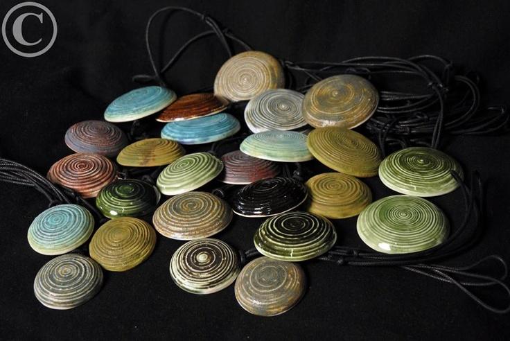 Hyrrä -pendants, porceline.  Design by Henna Lappalainen.